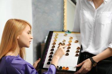 woman choosing color hair