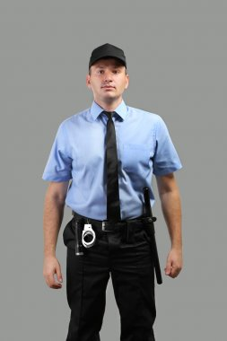 Male security guard on grey background stock vector