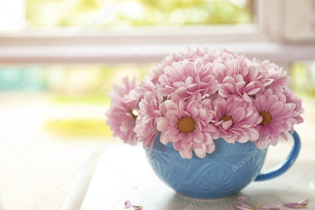 Bouquet of beautiful flowers in a cup on a table — Stock Photo ...