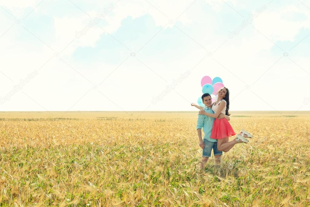 couple with toy air balloons
