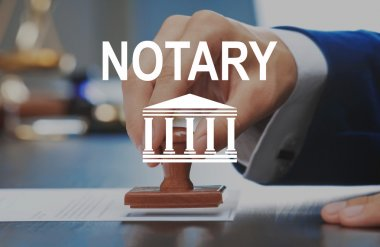 NOTARY. Notary public in office stamping document