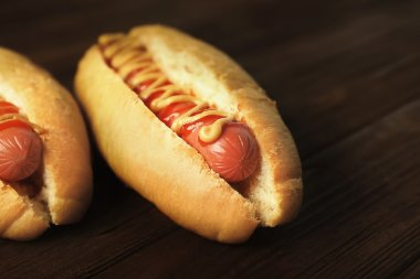 Tasty hot dogs on wooden background