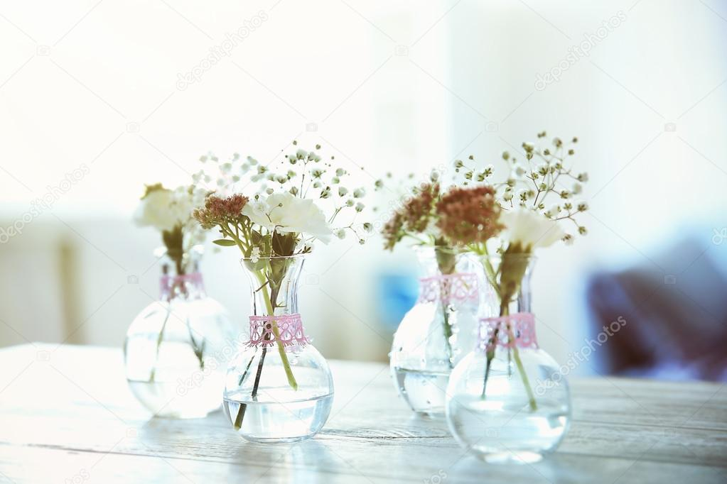 Mini Glass Vases With Flowers On Table Stock Photo Belchonock