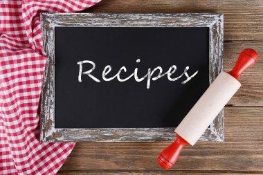 Recipes written on chalkboard, close-up