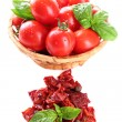 Sun dried tomatoes, fresh tomatoes in wicker basket,  basil leaves, isolated on white — стоковое фото #52101049