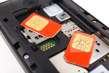 cell phone and two sim cards, close up