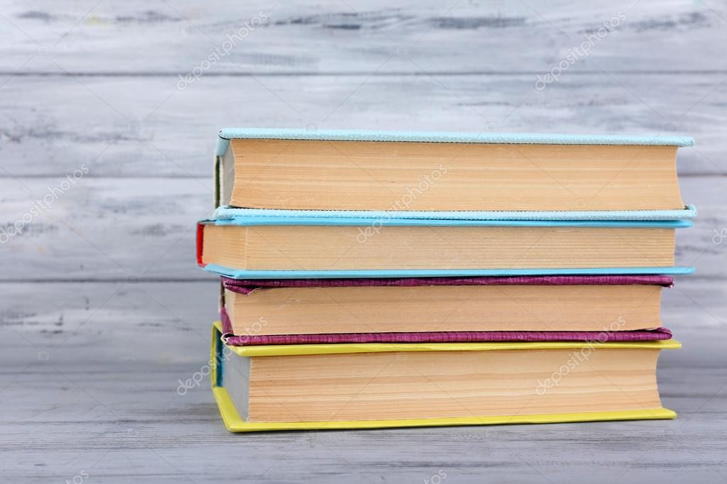 color books on grey wooden background — Stock Photo © belchonock ...