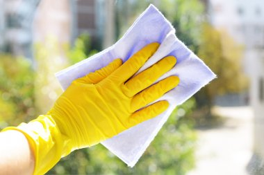 Cleaning windows with rag