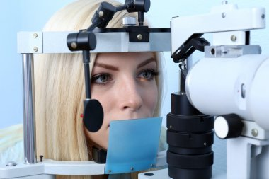 Woman having her eyes examined
