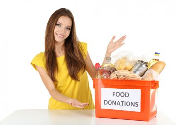 Girl volunteer with donation box