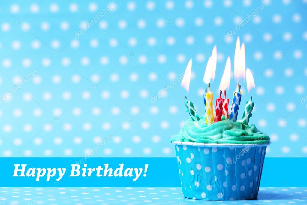 Delicious birthday cupcake on blue background — Stock ...