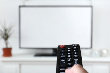 Watching TV and using remote controller stock vector