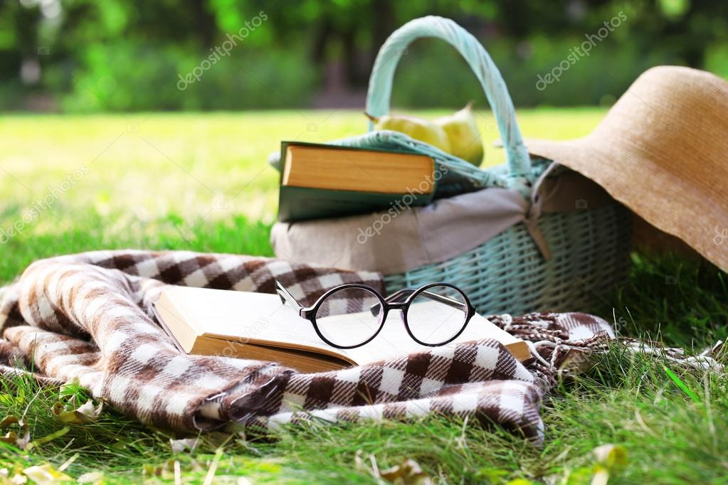 books, glasses bag and hat