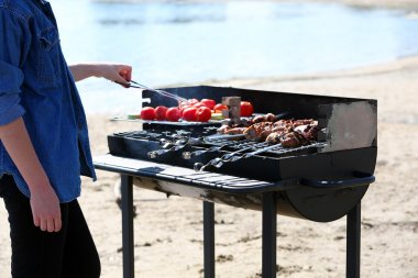 Sausages and vegetables on barbecue