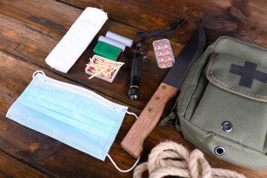 Emergency preparation equipment on wooden background stock vector