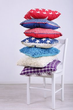 Bright pillows on chair