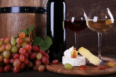 Camembert cheese, wine and grapes