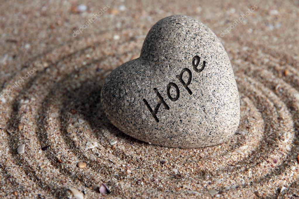 Grey zen stone in shape of heart, on sand background stock vector
