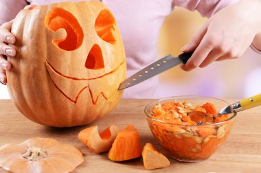 Hollowing out pumpkin to prepare halloween lantern