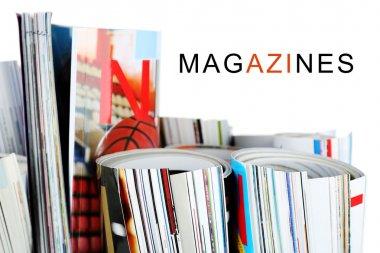 Many rolled magazines
