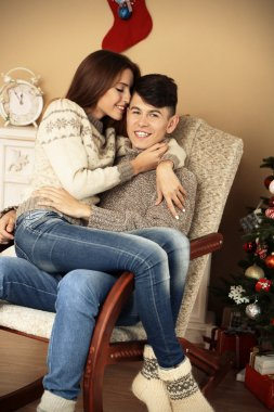 Couple  near Christmas tree