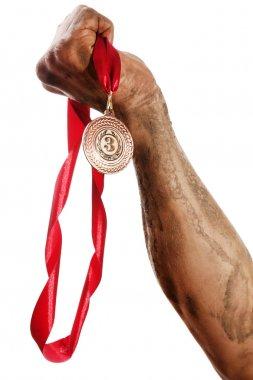 Golden medal in hand