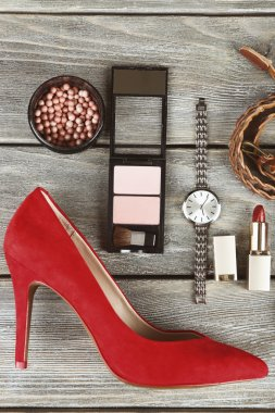 Essentials fashion woman objects on wooden background