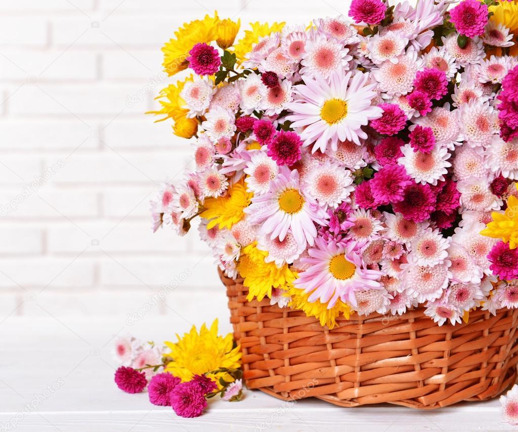 Beautiful flowers in wicker basket stock photo belchonock 60783575 beautiful flowers in wicker basket on table on light background photo by belchonock izmirmasajfo