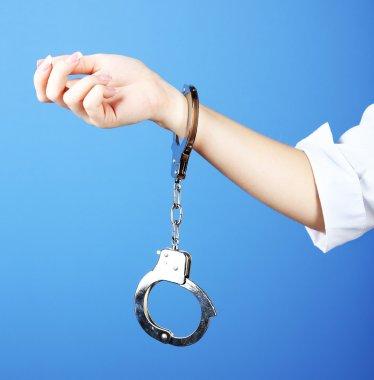 Female hand is handcuffed