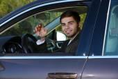 Fotografie Man with car key in car