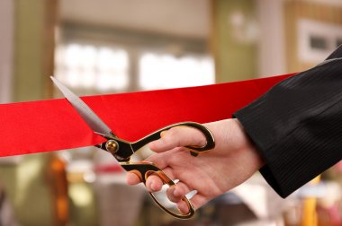 Grand opening, hand cutting red ribbon