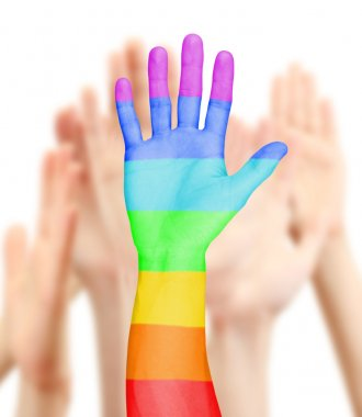 Man's hand painted as the rainbow flag on other hands background