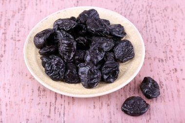 Plate with heap of prunes