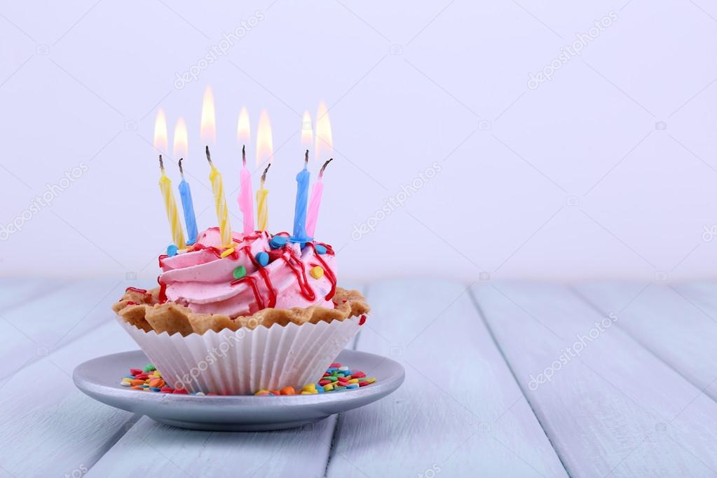 Birthday Cup Cake With Candles On Saucer And Sparkles Color Wooden Table Light Background Stock Image