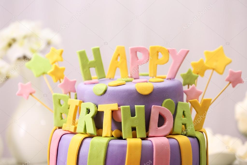 Delicious Birthday Cake On Table On Light Background Stock Photo