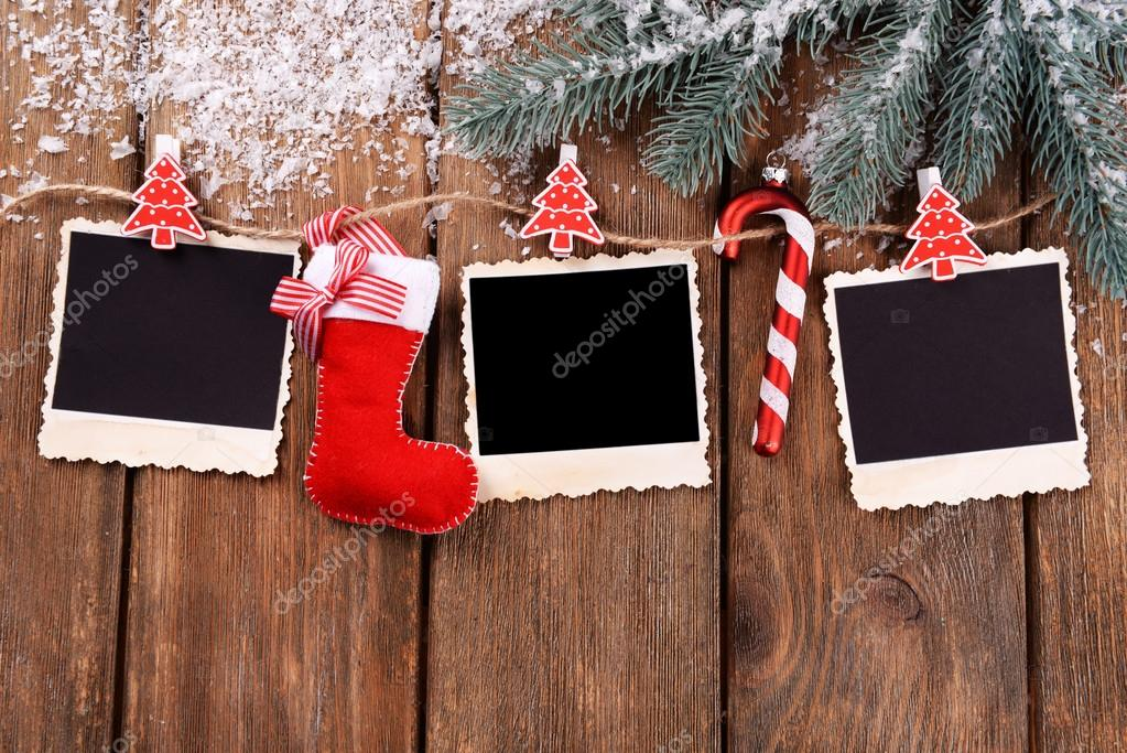 Blank Photo Frames And Christmas Decor With Snow Fir Tree On Wooden