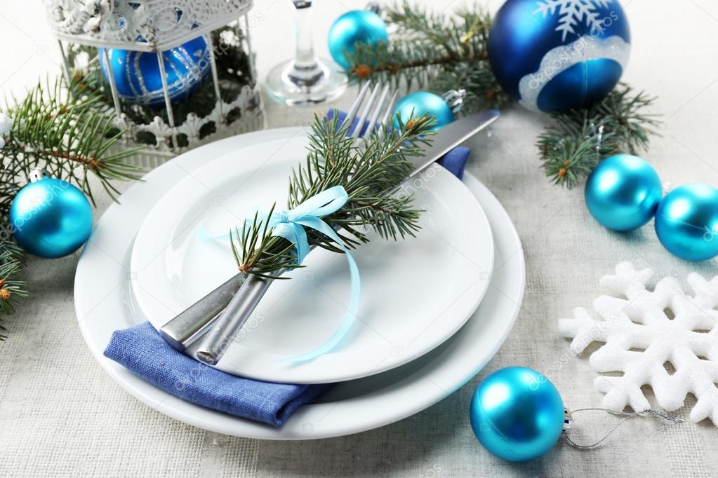 Stylish blue and white Christmas table setting on grey tablecloth ...