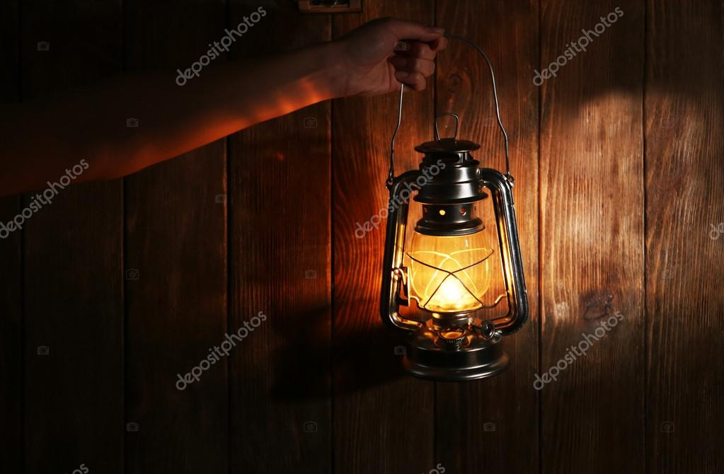Vintage lantern in hands