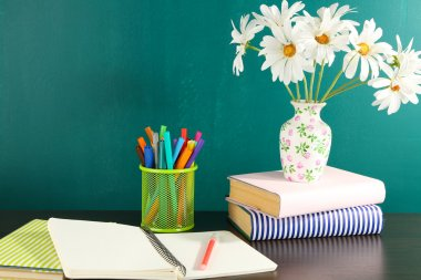 Desk with books and flowers