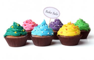 Delicious cupcakes with inscription isolated on white