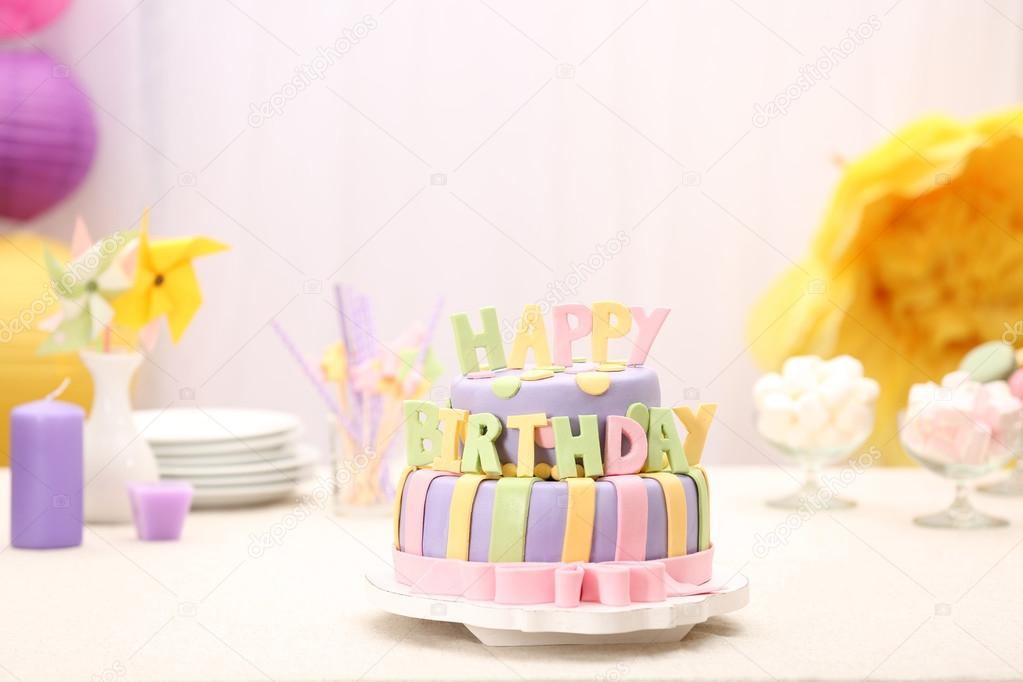 Delicious Birthday Cake On Table On Bright Background Stock Photo