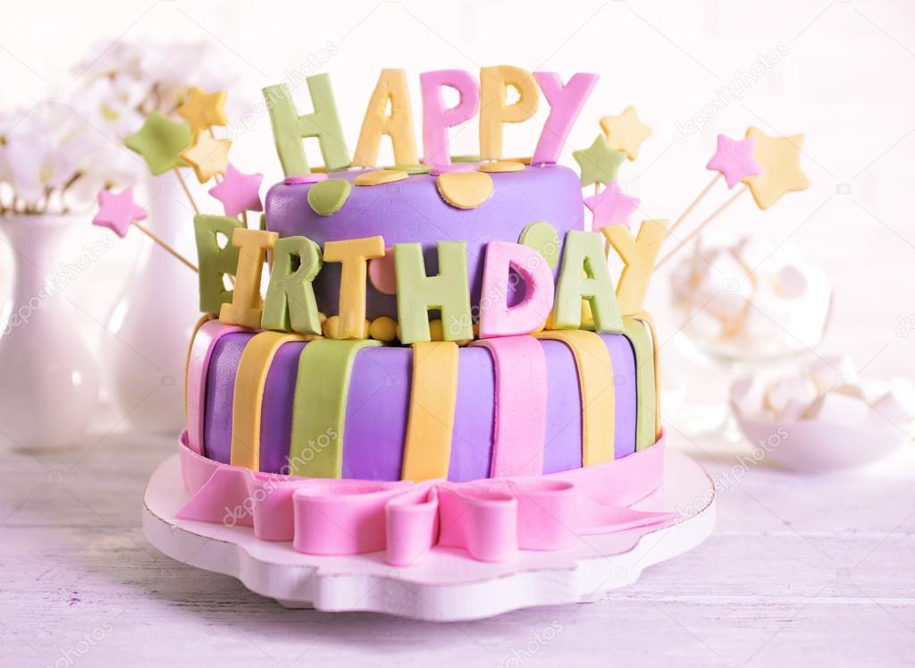 Delicious Birthday Cake On Table On Brick Wall Background Stock