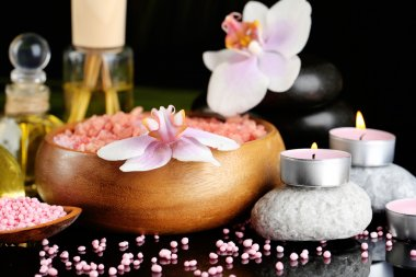 Beautiful spa composition with flowers on dark background