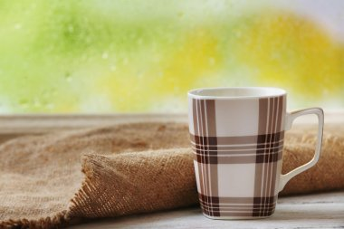 Cup of hot drink with sackcloth