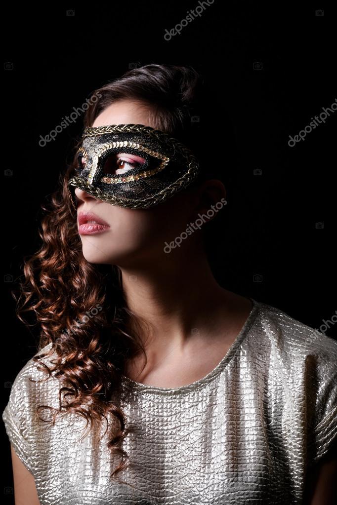 Beautiful girl with masquerade mask