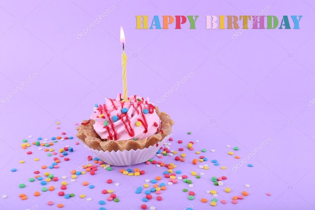 Birthday Cup Cake With Candle And Colorful Sparkles On Purple Background Stock Image