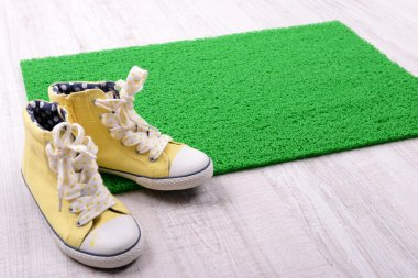 Green carpet and converse