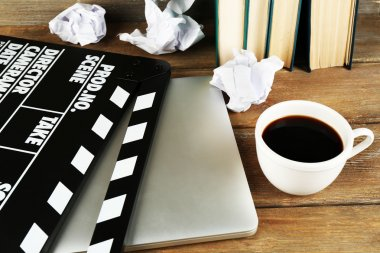 Movie clapper with laptop and coffee