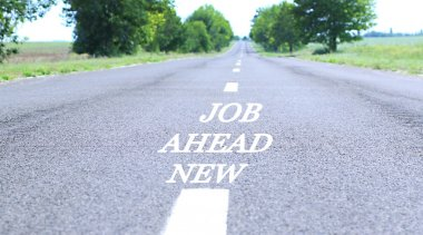 Text New Job Ahead marking on road surface