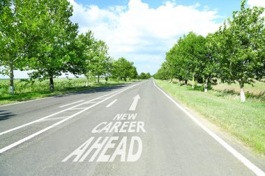 Text New Career Ahead with arrow marking on road surface